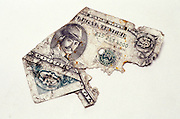 torn fake dollar bill