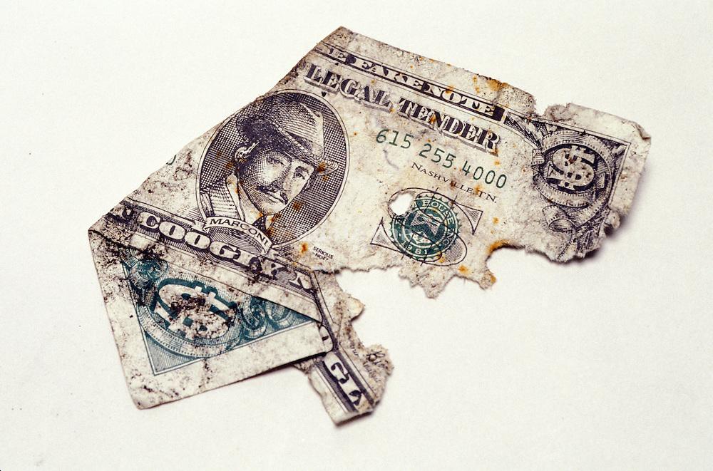 torn fake dollar bill