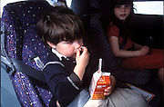 (MODEL RELEASED IMAGE). Children Andrea and Ryan are content in the backseat of the car after the Caven family stops at a McDonald's drive-thru in Napa, California, for Happy Meals on the way home from the weekly shopping expedition to Raley's, a California grocery chain. The high school where Craig teaches is on break this week, so the children are out of daycare and home with Dad. (Supporting image from the project Hungry Planet: What the World Eats.)