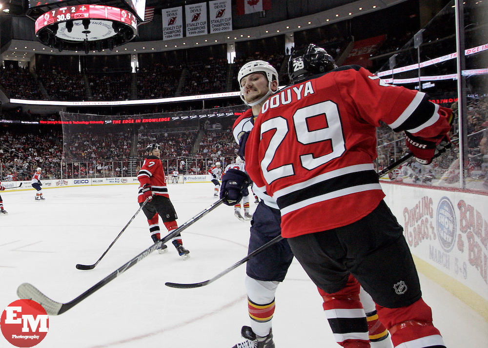 Feb 28, 2009; Newark, NJ, USA; Florida Panthers center Nick Tarnasky (74) hits New Jersey Devils defenseman Johnny Oduya (29) during the third period at the Prudential Center. The Devils defeated the Panthers 7-2.