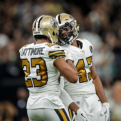 Nov 18, 2018; New Orleans, LA, USA; New Orleans Saints cornerback Marshon Lattimore (23) and safety Marcus Williams (43) celebrate a defensive stop during the second half against the Philadelphia Eagles at the Mercedes-Benz Superdome. Mandatory Credit: Derick E. Hingle-USA TODAY Sports