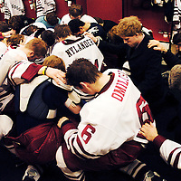 The Bozeman Icedogs kneel in prayer after winning at home against the Billings Bulls.