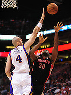 Mar. 23, 2011; Phoenix, AZ, USA; Toronto Raptors forward Reggie Evans (30) is blocked by the Phoenix Suns center Marcin Gortat (4) at the US Airways Center. Mandatory Credit: Jennifer Stewart-US PRESSWIRE