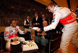STUTTGART, GERMANY - Monday, January 7, 2008: Lewis Hamilton cuts a cake for team-mate Heikki Kovalainen at launch of the Vodafone McLaren Mercedes MP4-23 Formula One car for the 2008 season at the Mecedez-Benz museum in Stuttgart. (Photo by Michael Kunkel/Hochzwei/Propaganda)