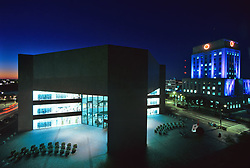Stock photo of an aerial night view of the Houston public library and City Hall in downtown Houston Texas