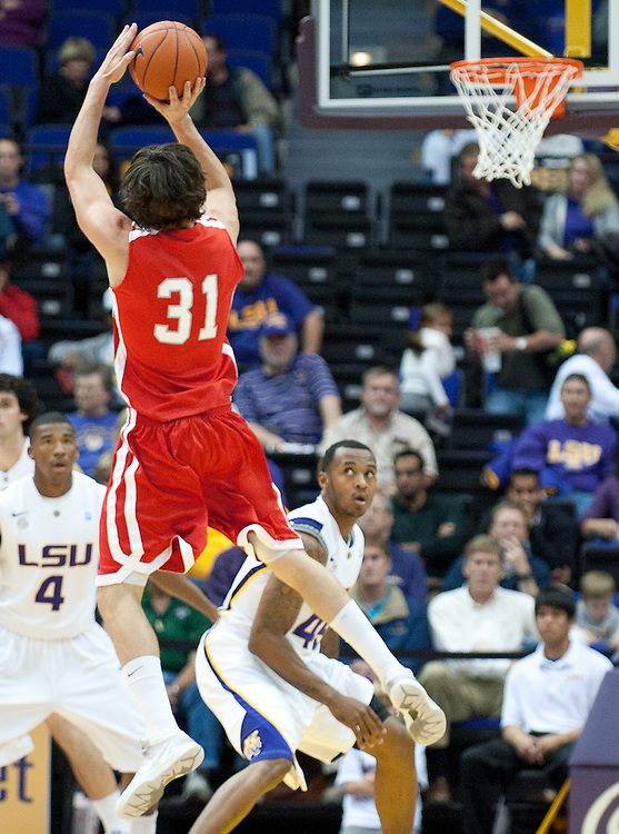 Nicholls State Colonels g-f Anatoly Bose (31) shoots a three point shot during the first half. LSU leads Nicholls State 25 to 21 at half time.