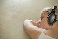 Portrait of a young woman relaxing with headdphones on
