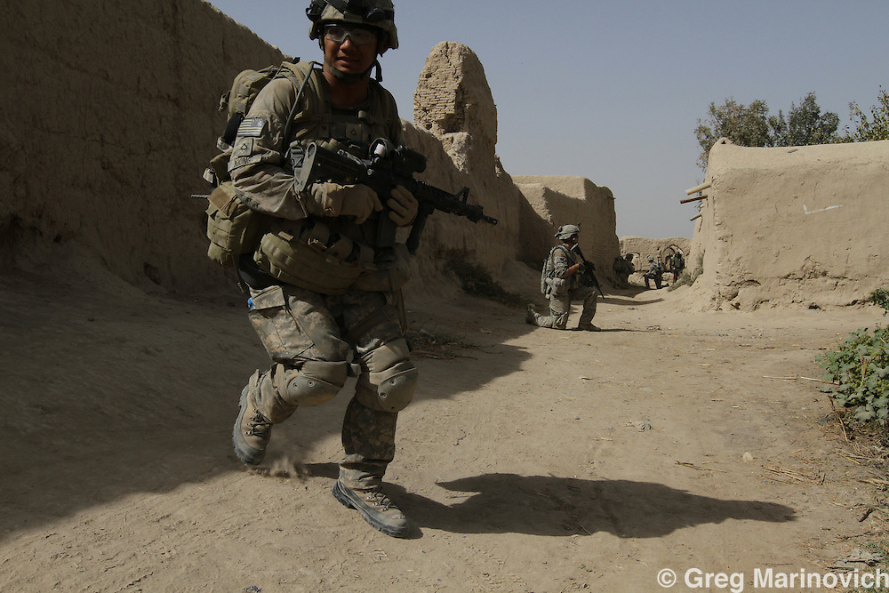 Afghanistan, Kandahar province, Arghandab district, checkpoint 16, 22rd Oct 2010. Taskforce1-66 (66th Armoured Regiment), 4th Infantry Div. Charlie company on patrol from Combat Outpost Brunkhorst to COP Caron, stop at Checkpoint 16 where the squad had discovered a IED the day before and wanted to receheck the area, a crossroads that is a hotspot for IED's and landmines. Soldier in front is Private First Class Xiong, the medic who treated Joao the next day when he triggered a landmine. Photo Joao Silva.