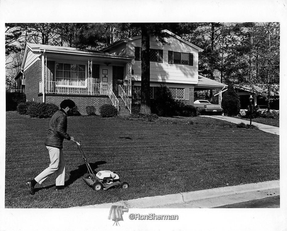 Atlanta GA middle class homeowner, Cascade Heights, cutting his lawn.