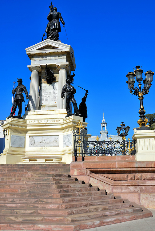 Monument to the Heroes of Iquique in Valpara&iacute;so, Chile<br /> The Battle of Iquique consisted of two naval confrontations against Peru during the War of the Pacific in 1879. The Monumento a los H&eacute;roes de Iquique was erected at Plaza Sotomayor in 1886 in memory of the fallen Chilean sailors.  On top is a statue of Arturo Prat who died while commanding the Esmeralda.  Below him are other sculptures by Pierre Dennis. Beneath this tribute is a vault with several of the heroes&rsquo; remains.
