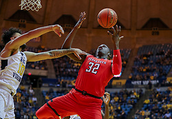 Jan 2, 2019; Morgantown, WV, USA; Texas Tech Red Raiders center Norense Odiase (32) rebounds the ball during the first half against the West Virginia Mountaineers at WVU Coliseum. Mandatory Credit: Ben Queen-USA TODAY Sports
