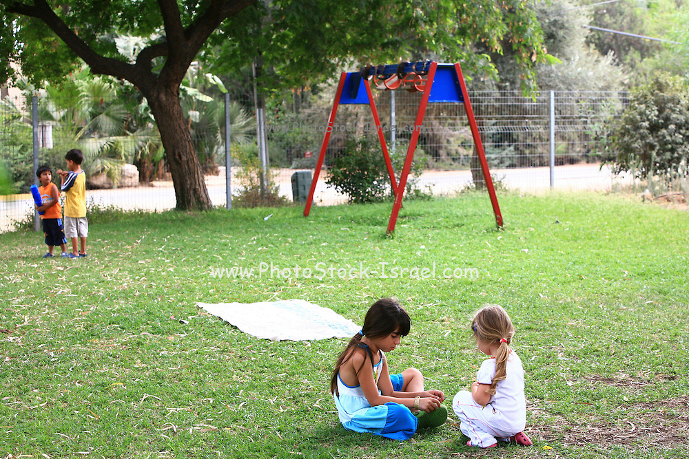 Israel, moshav Sde Yitzhak. Children play in the playground at the settlement