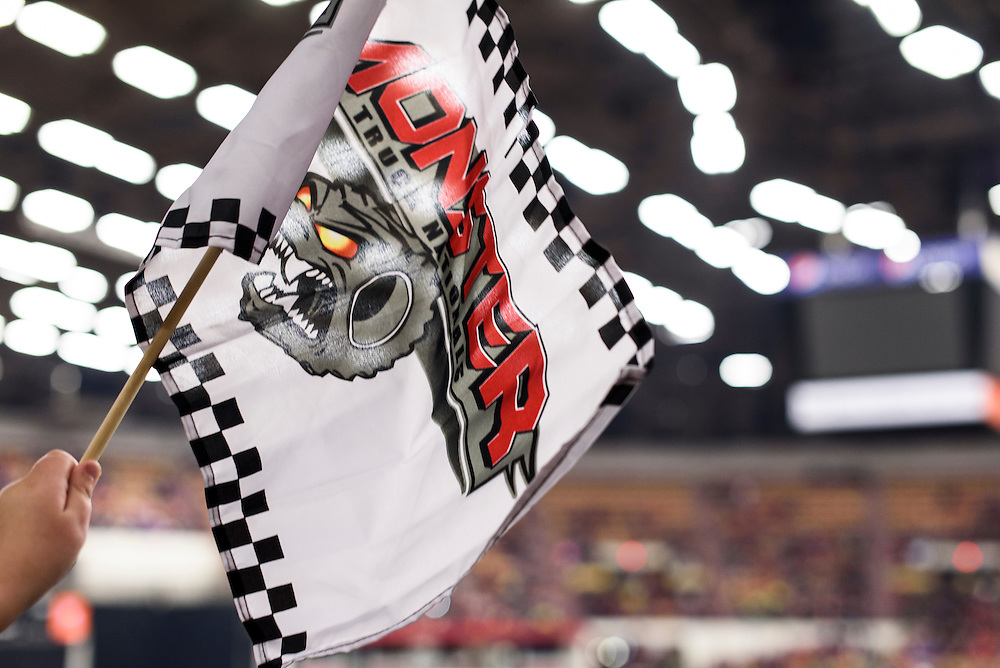 A fan waves a rally flag during the Monster Truck Nationals at the Veterans Memorial Coliseum at the Alliant Energy Center in Madison, Wis., on Jan. 31, 2016. (Photo by Jeff Miller, www.jeffmillerphotography.com)