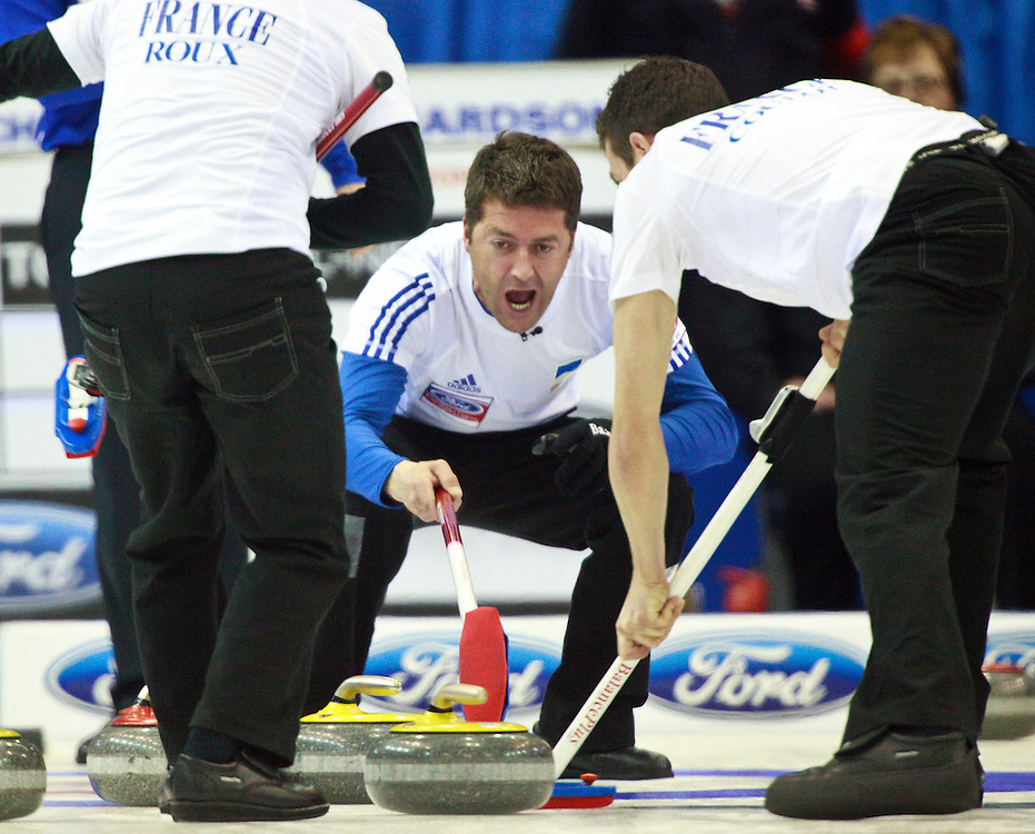 France's skip Thomas Dufour, encourages his sweepers during their  9-7 win over the United States in the evening draw at the Ford World Men's Curling Championships at the Brandt Centre in Regina, Saskatchewan, April 7, 2011.<br /> AFP PHOTO/Geoff Robins