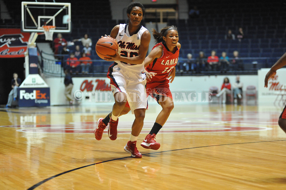 "Ole Miss' Amber Singletary (20) vs. Lamar's Carenn Baylor (14) in women's college basketball at the C.M. ""Tad"" Smith Coliseum in Oxford, Miss. on Monday, November 19, 2012.  Lamar won 85-71."