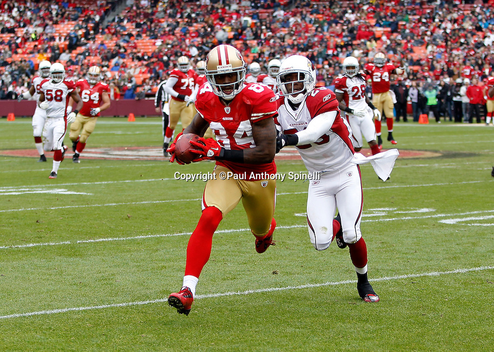 San Francisco 49ers wide receiver Josh Morgan (84) catches a first quarter pass while covered by Arizona Cardinals cornerback Dominique Rodgers-Cromartie (29) during the NFL week 17 football game against the Arizona Cardinals on Sunday, January 2, 2011 in San Francisco, California. The 49ers won the game 38-7. (©Paul Anthony Spinelli)