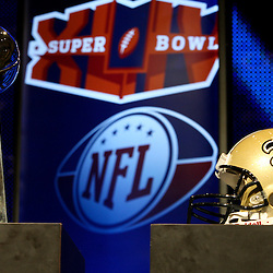 Feb 05, 2010;  Fort Lauderdale, FL, USA; The New Orleans Saints team helmet on display with the Vince Lombardi Trophy at the Super Bowl XLIV media center at the Fort Lauderdale/Broward County Convention Center. Mandatory Credit: Derick E. Hingle