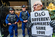 "The police arrive to keep the store open. The Out and Proud Diamond Group and the Peter Tatchell Foundation support the international boycott of Dolce and Gabbana and lead a protest outside their flagship London store, 6-8 Old Bond Street, London 19 March 2015. The protest is in response to the fashion designers 'insulting slurs' against same-sex parents and their children. Speaking to the Italian magazine Panorama, alongside his business partner, Stefano Gabbana, Domenico Dolce said children should be born to a mother and a father: ""The only family is a traditional one. I'm not convinced by those I call the chemical children, synthetic babies...They are wombs for hire, semen chosen from a catalogue ... psychiatrists are not ready to confront the effects of this experimentation."" Stefano Gabbana added: ""The family is not a fad."" In 2006, he told the Daily Mail: ""I am opposed to the idea of a child growing up with two gay parents."""