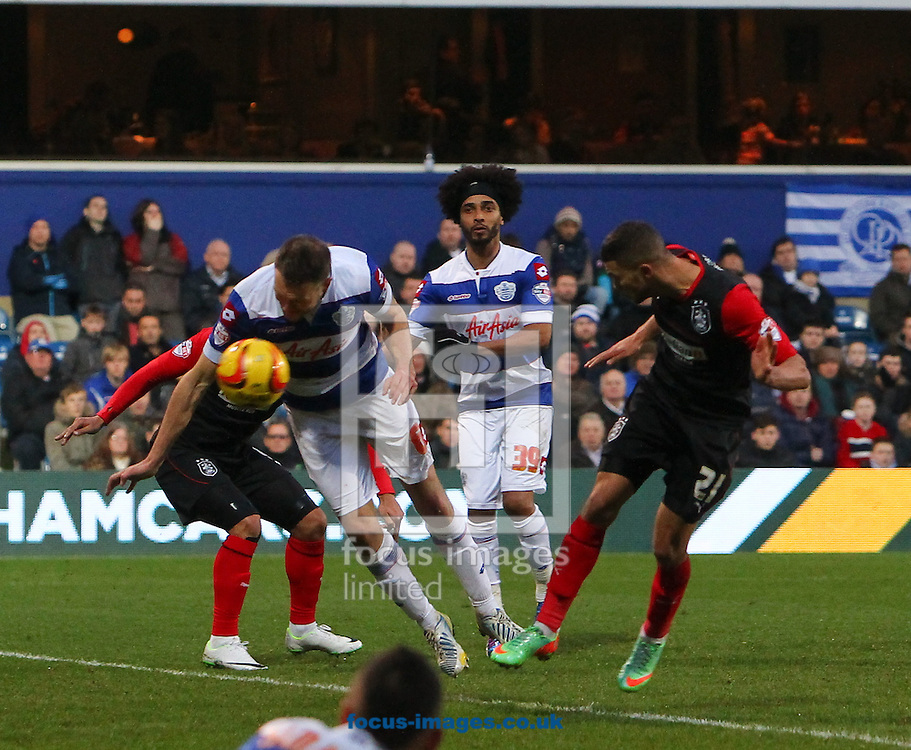 Picture by John Rainford/Focus Images Ltd +44 7506 538356<br /> 18/01/2014<br /> Clint Hill of Queens Park Rangers can't stop Nahki Wells of Huddersfield Town from scoring the equaliser during the Sky Bet Championship match at the Loftus Road Stadium, London.