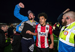 Troy Brown of Exeter City is mobbed by fans at the final whistle - Mandatory by-line: Gary Day/JMP - 18/05/2017 - FOOTBALL - St James Park - Exeter, England - Exeter City v Carlisle United - Sky Bet League Two Play-off Semi-Final 2nd Leg