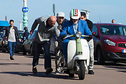 Mod scooterist gets a push when his scooter breaks down during the Brighton & Hove Albion Football Club Promotion Parade at Brighton Seafront, Brighton, East Sussex. United Kingdom on 14 May 2017. Photo by Ellie Hoad.