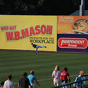 Catcher Matt Koch, New Britain Rock Cats, warmed up as fans walk their dogs during the 'Bark in the Park' owners with their dogs day before the New Britain Rock Cats Vs Binghamton Mets Minor League Baseball game at New Britain Stadium, New Britain, Connecticut, USA. 2nd July 2014. Photo Tim Clayton