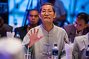 15 DECEMBER 2013 - BANGKOK, THAILAND:    A man speaks during a forum on political reform in Thailand at the Queen Sirikit National Convention Center. The forum was organized by Thai Prime Minister Yingluck Shinawatra.      PHOTO BY JACK KURTZ