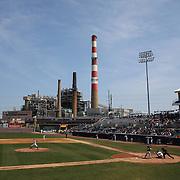 The Bridgeport Harbor Power Station provides a back drop to the ballpark during the Bridgeport Bluefish V York Revolution, Atlantic League, Minor League ballgame at Harbor Yard Ballpark, Bridgeport, Connecticut, USA. Photo Tim Clayton