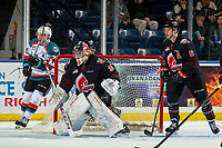 KELOWNA, CANADA - JANUARY 16: Kyle Topping #24 of the Kelowna Rockets skates from behind the net looking for the pass as Brodan Salmond #30 of the Moose Jaw Warriors defends the net during third period on January 16, 2019 at Prospera Place in Kelowna, British Columbia, Canada.  (Photo by Marissa Baecker/Shoot the Breeze)