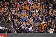 San Francisco Giants fans celebrate a home run hit by right fielder Hunter Pence (8) against the Colorado Rockies at AT&T Park in San Francisco, Calif., on September 27, 2016. (Stan Olszewski/Special to S.F. Examiner)