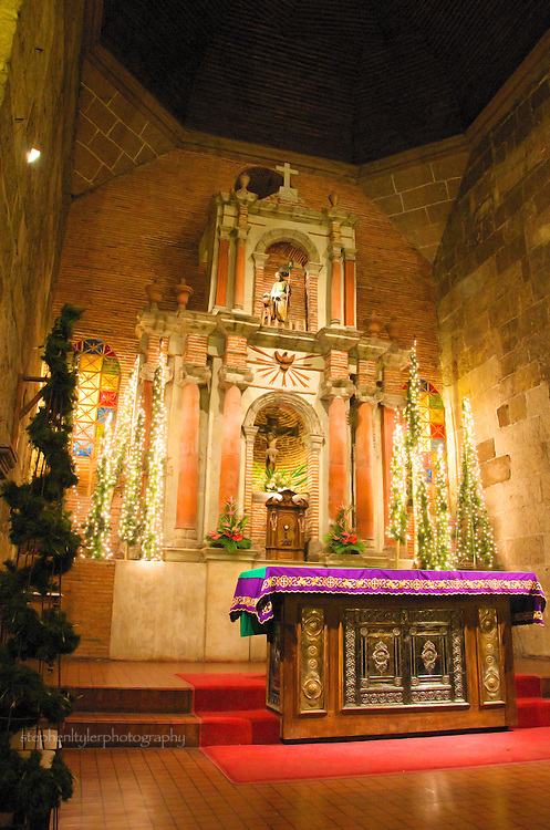 The alter inside St. Joseph's Church of the Bamboo Organ in Las Pinas during Simbang Gabi, where nine straight nights of Mass is celebrated at 4 AM and leads up to the Midnight Mass on Christmas eve.