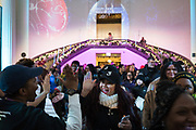 "People arrive at a holiday event thrown by SocialWorks called ""A Night at The Museum"" at the Field Museum on December 20, 2017."