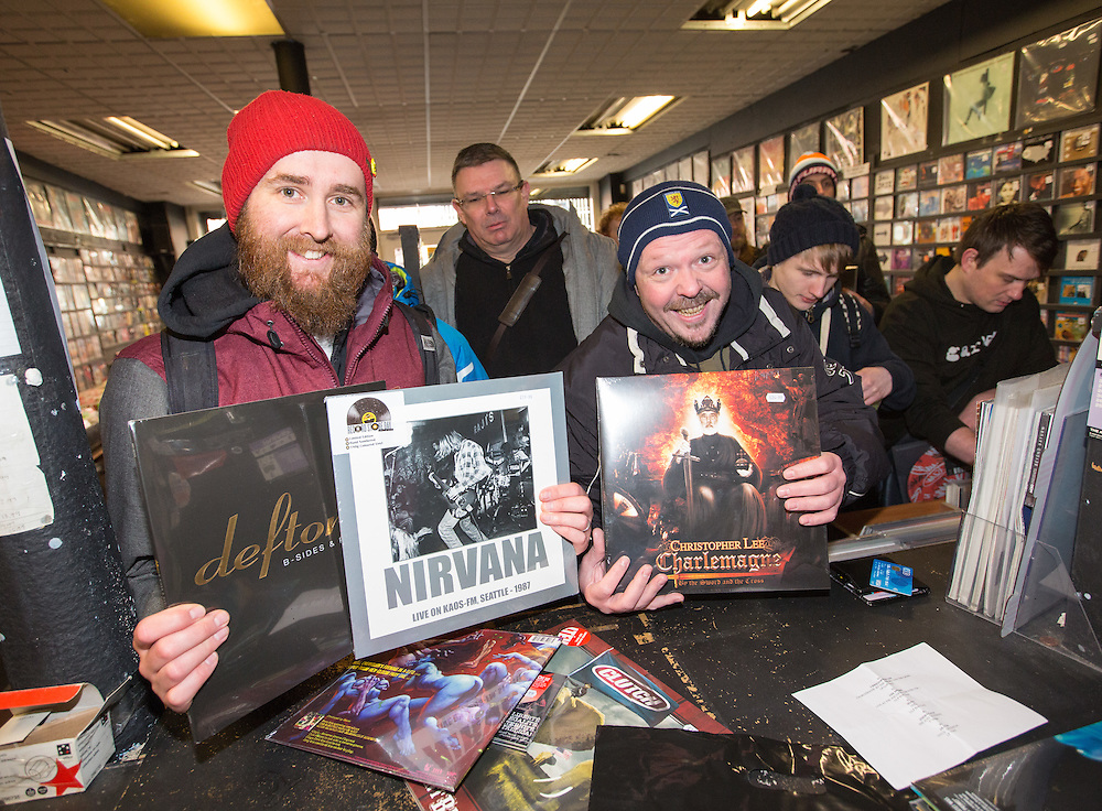 Music fans out in their numbers for Record Store Day. The Love Music shop on Dundas Street, Glasgow. Andy McKenzie and Joe Embleton, both of Glasgow get their merchandise. Picture Robert Perry 16th April 2016<br /> <br /> Must credit photo to Robert Perry<br /> FEE PAYABLE FOR REPRO USE<br /> FEE PAYABLE FOR ALL INTERNET USE<br /> www.robertperry.co.uk<br /> <br /> NB -This image is not to be distributed without the prior consent of the copyright holder.<br /> in using this image you agree to abide by terms and conditions as stated in this caption.<br /> All monies payable to Robert Perry<br /> <br /> (PLEASE DO NOT REMOVE THIS CAPTION)<br /> This image is intended for Editorial use (e.g. news). Any commercial or promotional use requires additional clearance. <br /> Copyright 2016 All rights protected.<br /> first use only<br /> contact details<br /> Robert Perry     <br /> 07702 631 477<br /> robertperryphotos@gmail.com<br />        <br /> Robert Perry reserves the right to pursue unauthorised use of this image . If you violate my intellectual property you may be liable for  damages, loss of income, and profits you derive from the use of this image.