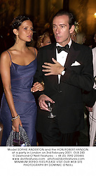 Model SOPHIE ANDERTON and the HON.ROBERT HANSON at a party in London on 3rd February 2001.	OLB 240