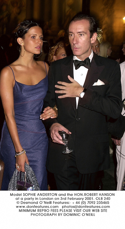 Model SOPHIE ANDERTON and the HON.ROBERT HANSON at a party in London on 3rd February 2001.OLB 240