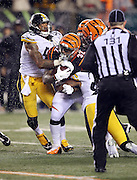 Pittsburgh Steelers inside linebacker Ryan Shazier (50) strips the ball from Cincinnati Bengals running back Jeremy Hill (32) on a late fourth quarter play in which Hill fumbles and the Pittsburgh Steelers recover the loose ball, leading to the Steelers dramatic comeback win, during the NFL AFC Wild Card playoff football game against the Pittsburgh Steelers on Saturday, Jan. 9, 2016 in Cincinnati. The Steelers won the game 18-16. (©Paul Anthony Spinelli)