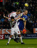 Photo: Steve Bond/Richard Lane Photography. Leicester City v Crystal Palace. E.ON FA Cup Third Round. 03/01/2009. Steve Howard (R), Jose Fonte (L) and Leandre Griffet (C) in the air
