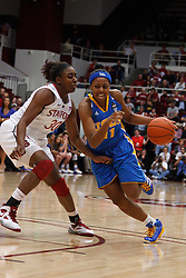 January 20, 2011; Stanford, CA, USA;  UCLA Bruins guard/forward Atonye Nyingifa (11) is defended by Stanford Cardinal forward Nnemkadi Ogwumike (30) during the first half at Maples Pavilion.