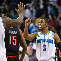 January 17, 2011; New Orleans, LA, USA; New Orleans Hornets point guard Chris Paul (3) celebrates with center Emeka Okafor (50) following a win over the Toronto Raptors at the New Orleans Arena. The Hornets defeated the Raptors 85-81.  Mandatory Credit: Derick E. Hingle