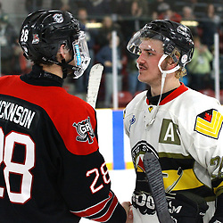 TRENTON, ON  - MAY 5,  2017: Canadian Junior Hockey League, Central Canadian Jr. &quot;A&quot; Championship. The Dudley Hewitt Cup Game 7 between Georgetown Raiders and the Powassan Voodoos.   Josh Dickinson #28 of the Georgetown Raiders and  Dayton Murray #20 of the Powassan Voodoos shake hands post game.<br /> (Photo by Alex D'Addese / OJHL Images)