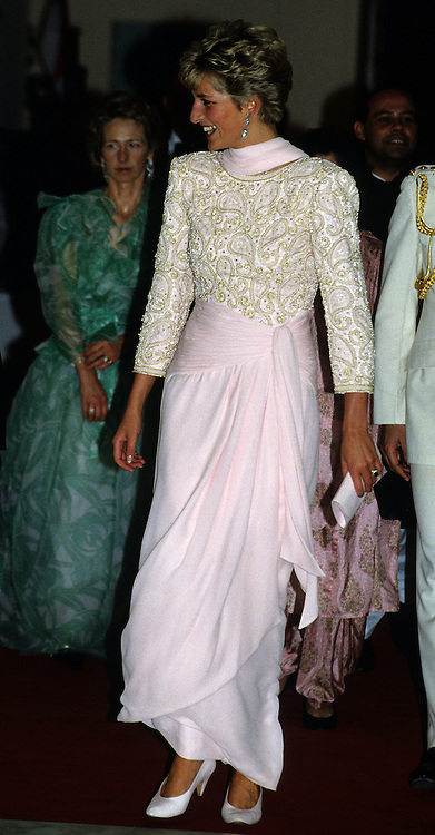 Diana, Princess of Wales wears a Catherine Walker sarong style evening dress in pink chiffon during her visit to Pakistan in October 1991.<br />