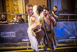 "© Licensed to London News Pictures . 19/12/2015 . Manchester , UK . People outside a club in the "" Gay Village "" .Revellers in Manchester enjoy "" Mad Friday "" - also known as "" Black Eye Friday "" - the day on which emergency services in Britain are typically at their busiest , as people head out for parties and drinks to celebrate Christmas . Photo credit : Joel Goodman/LNP"