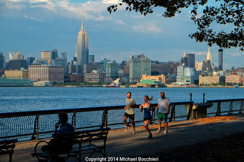 HOBOKEN, NJ - August 13:  People run in the park on August 13, 2014 in HOBOKEN, NJ.  (Photo by Michael Bocchieri/Bocchieri Archive)