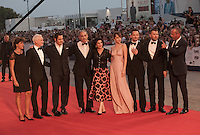 The cast including Producer Patrick McCormick, actor Johnny Depp, producer John Lesher, Sue Kroll, acctress Dakota Johnson, director Scott Cooper, Joel Edgerton at the gala screening for the film Black Mass at the 72nd Venice Film Festival, Friday September 4th 2015, Venice Lido, Italy.