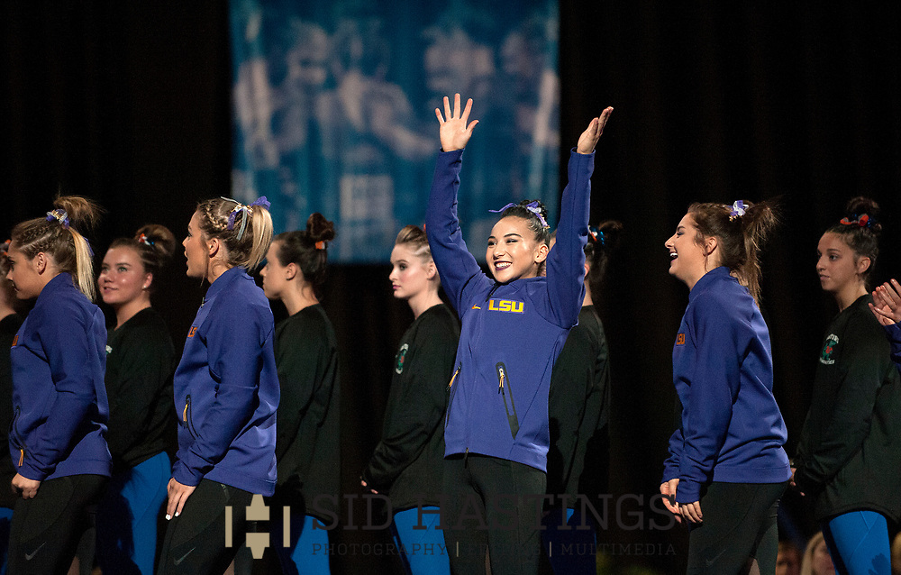 21 APRIL 2018 -- ST. LOUIS -- LSU gymnast Myia Hambrick (center) is introduced during the opening of the 2018 NCAA Women's Gymnastics Championship Super Six at Chaifetz Arena in St. Louis Saturday, April 21, 2018.<br /> Photo &copy; copyright 2018 Sid Hastings.