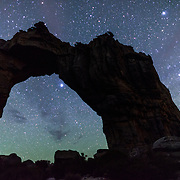 Star filled sky over the Wolfberg rock arch in the Cederberg mountains of South Africa.