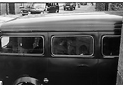 Images at Rose Dugdale Trial..1974..23.05.1974..05.23.1974..23d May 1974..Arrested after the theft of Irl£8 million worth of Old Master paintings from the collection of Sir Alfred Beit at Russborough House ,Wicklow, Bridget 'Rose' Dugdale was sent for trial at the Special Criminal Court in Green Street,Dublin. She was to be tried under Section 30 of The Offences Against the State Act. Miss Dugdale was connected to the Provisional I.R.A. and was implicated in the bombing of an R.U.C. station in Northern Ireland with her partner Eddie Gallagher. Her trial was held under massed security as there were fears of mass protests by IRA and Dugdale supporters...Picture shows the van containing Rose Dugdale,under heavy escort security,arriving at Green Street Court,Dublin.