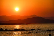Beautiful orange and red Sunset over Crete, Greece