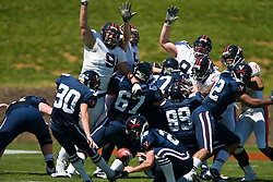Virginia's special teams try to block a FG attempt by Virginia place kicker Robert Randolph (30).  The Virginia Cavaliers football team played the annual spring football scrimmage at Scott Stadium on the Grounds of the University of Virginia in Charlottesville, VA on April 18, 2009.  (Special to the Daily Progress / Jason O. Watson)