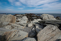 Rocks and sky by the sea shore. Rocky beach along the Sachuest Point National Wildlife Refuge